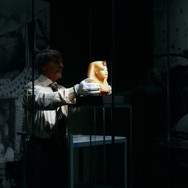 An Egyptian courier installs the lid to a canopic jar that once housed ...
