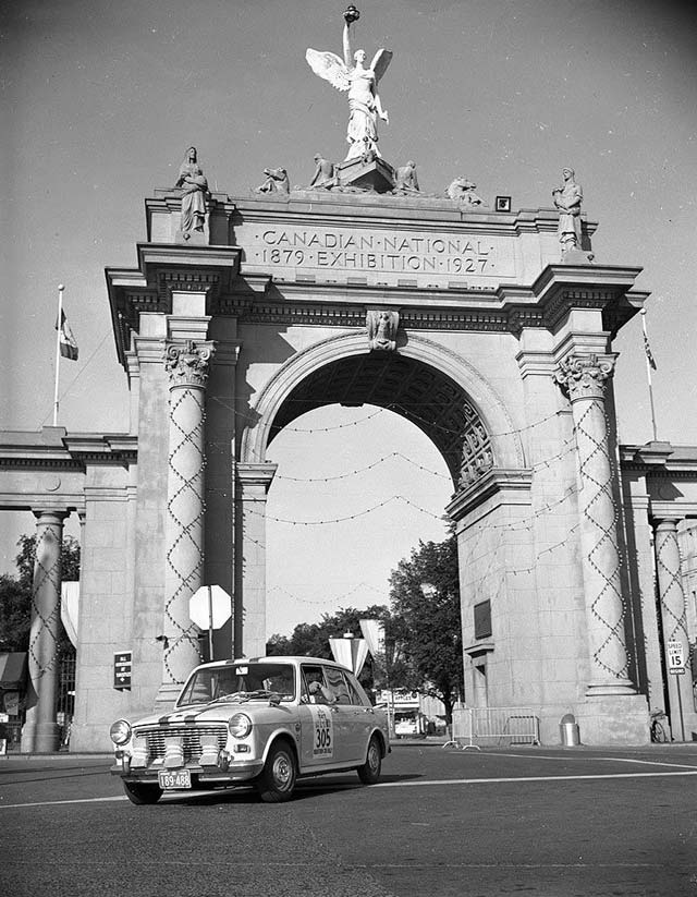 Had several of those interviewed by the Telegram had their way, the Princes' Gates would not be greeting visitors this year. Car 305, leaving CNE grounds via Princes' Gates, at start of CNE's first marathon car rally, 1965. City of Toronto Archives, Fonds 1257, Series 1057, Item 5802.