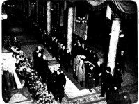 """Some of the thousands of citizens who passed through [Old] City Hall today to pay their final respects to Mayor Sam McBride as he lay in state are shown above with a few of the many handsome floral tributes and the solemn procession inside the building."" The Telegram, November 16, 1936."