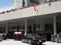 Layton's casket is carried out of the City Hall rotunda, where Layton had been lying in state.