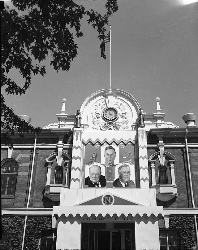 Illustration of the restaurant's namesake, Winston Churchill, along with King George VI and Franklin Delano Roosevelt on a banner over the entrance of the CNE Press Building, 1940s. City of Toronto Archives, Fonds 1257, Series 1057, Item 5683.
