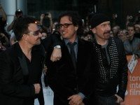 Bono, producer Davis Guggenheim, and The Edge outside Roy Thomson Hall.