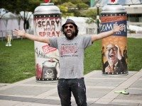 Star of Exit Through the Gift Shop and potential Banksy-proxy Mr. Brainwash showing off his giant spray cans outside the red carpet.