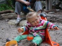 Three-year-old Zoe tests her sandbox chair.