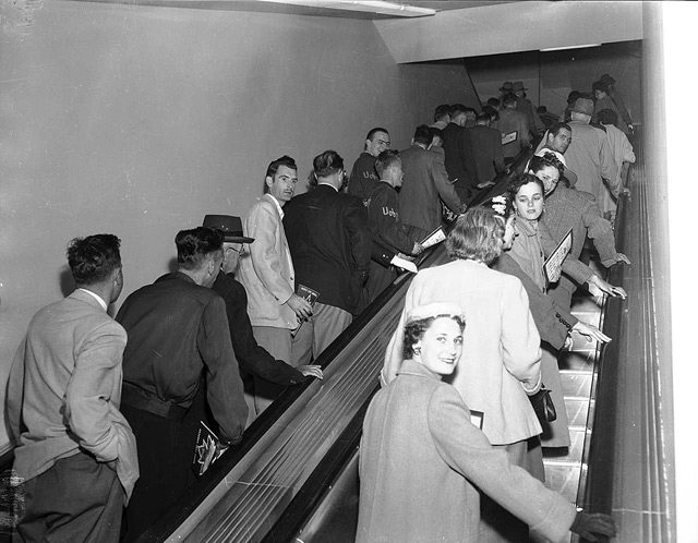 Crowds on new escalators, Maple Leaf Gardens, 1955.