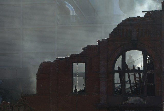 The gutted remains of a heritage building after a six-alarm fire at the site, formerly the location of the Empress Hotel.