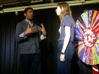 Improviser Darryl Hinds plays with a Second City student at the Wheel of Improv show. Photo by Natasha Boomer.