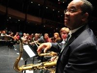 Victor Goines instructs students during the 2009 Essentially Ellington competition. Photo by Frank Stewart for Jazz at Lincoln Center.