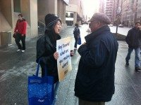 Volunteer Nong Li chats with a pedestrian. He likes books on finance.