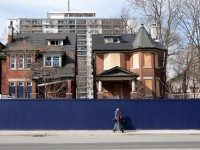 The boarded up houses at 1844 Bloor Street West are currently being demolished. Photo by Dean Bradley.