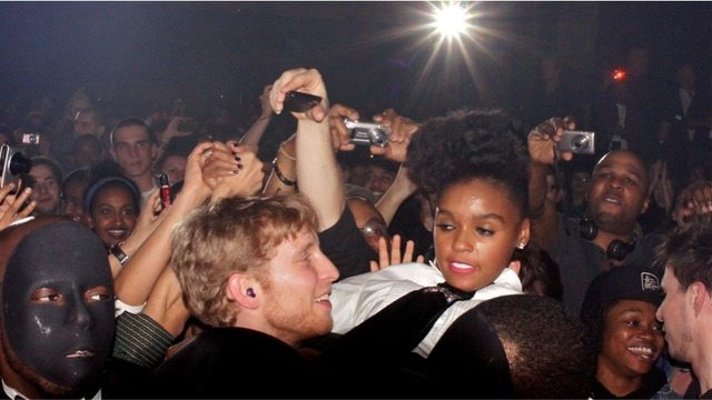Janelle Monáe goes crowd surfing at the 2011 Indie Awards, while audience members snap pictures and a creepy man wears a black mask  Ah, CMW  Photo by Roger Cullman, from the Torontoist Flickr Pool