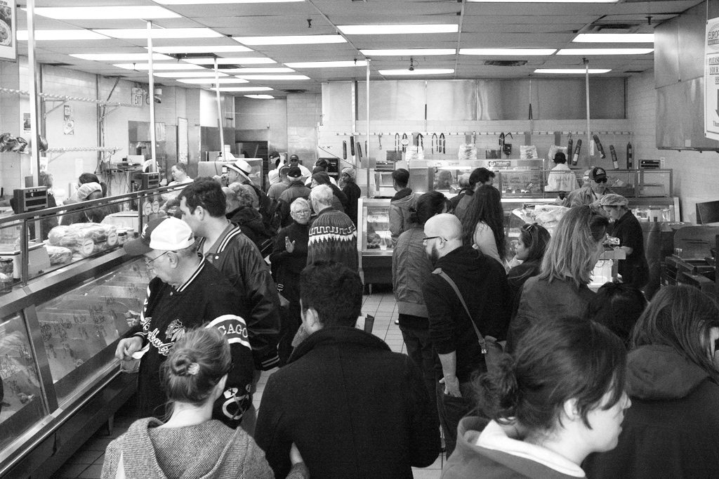 Customers line up to make their final purchases before the store closes.