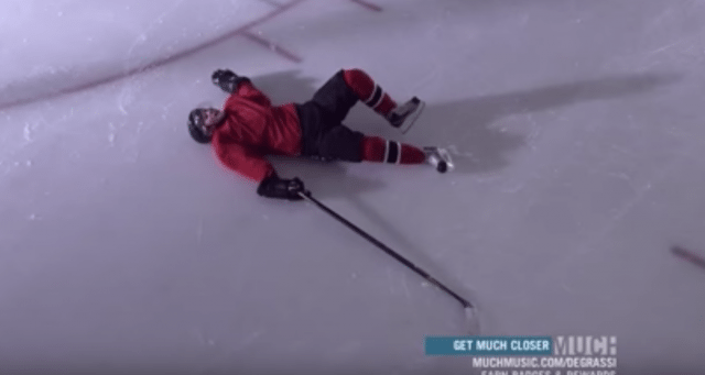 Cam lies on the ice after an intense punishment practice.