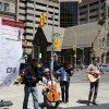 The Benefit of the Free Man perform at Avenue and Bloor. (Dean Bradley/Torontoist)