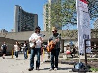 Colin Gibson and Matthew Thompson perform at Nathan Phillips Square. (Dean Bradley/Torontoist)