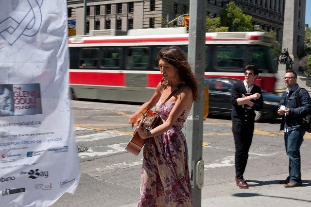 Amy Nostbakken performs at the corner of University and Queen. (Dean Bradley/Torontoist)