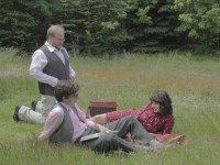 Mark Little and Evany Rosen lounge on the grass (while Brian Macquarrie looks on) in a scene from the season (and possible series) finale of Picnicface.
