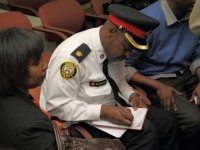 Police superintentent Mark Saunders takes notes during a meeting on police carding and racial profiling.