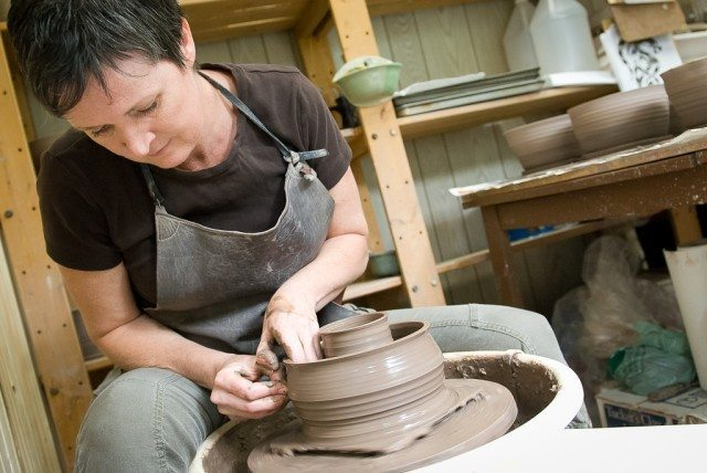Kim Henderson, at her pottery wheel.