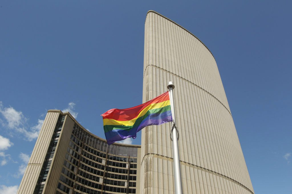The rainbow flag flies over City Hall. Photo by Christopher Drost.
