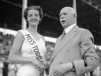 Mayor William D. Robbins presenting Miss Toronto silk sash to Billie Hallam, 1937, City of Toronto Archives, Fonds 1257, Series 1057, Item 1448.
