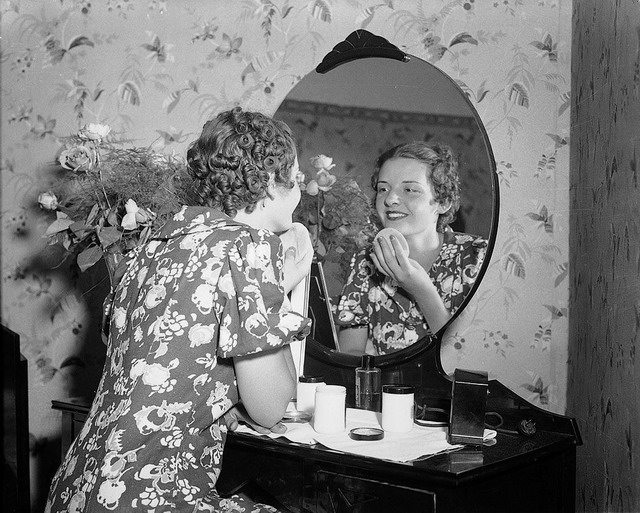 Billie Hallam applying make-up in her bedroom, 1937, City of Toronto Archives, Fonds 1257, Series 1057, Item 1481.