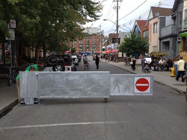 The city, in partnership with Kensington Market's BIA, installed these semi-permanent swing gates earlier this summer to facilitate more-frequent street closures. Photo by Yvonne Bambrick.