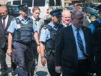 Mayor Rob Ford, on his way out of the courthouse during his hearing in September.