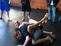 Sean Pierson and Mark Bocek demonstrate a kimura for members of the media.