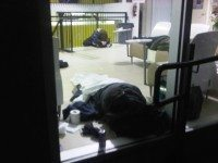 Patrons at the Streets to Homes Assessment and Referral Centre sleep in the lobby of the building. Photo by Desmond Cole.