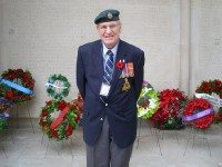 Gary Knopf, a Legion member with 8th Signal Regiment, stands in front of the wreaths at the Soldiers' Tower.