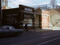 A cycling riding in front of St. Patrick's Market on Queen Street, 1970s. Photo by Ellis Wiley. City of Toronto Archives, Fonds 124, File 2, Item 125.