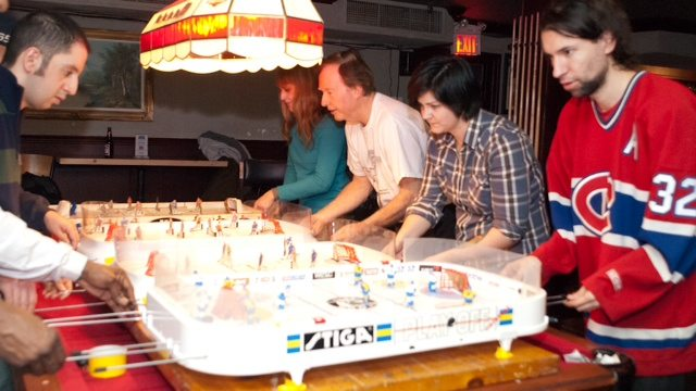 Present-day competitive table hockey. Photo by Corbin Smith/Torontoist.