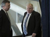 Rob Ford and his press secretary, George Christopoulos, at a press conference following the release of the Divisional Court's decision on Friday.