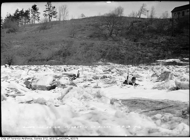 Two men indicating the height of the ice. City of Toronto Archives. Fonds 200, Series 372, Subseries 84, Item 76.