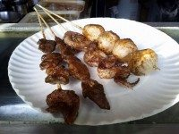 Lamb, squid, and cuttlefish skewers from the Chinatown lamb kebab stall. Photo by Sarah Efron.