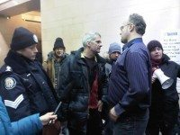 OCAP's John Clarke (centre) and other protesters confront city staff in the lobby of Metro Hall last Friday to demand increased funding for shelters. Photo by Desmond Cole.