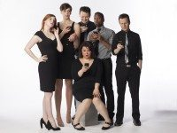 The Second City cast take a minute to check their Twitters.