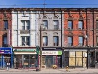 Early Sunday Morning showcases Toronto's colourful, and disappearing, heritage streetscapes. Photo by David Kaufman.