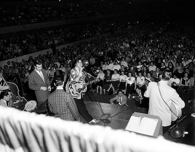 Presley on stage during a show the previous night in Buffalo, from the York University Libraries, Clara Thomas Archives & Special Collections, Toronto Telegram fonds, F0433, ASC00835