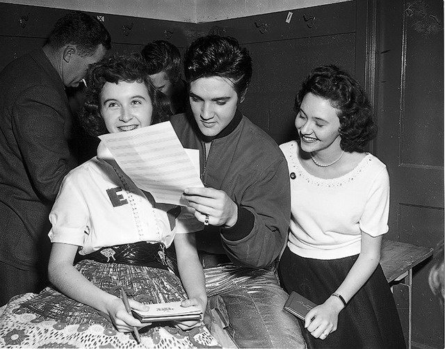 Presley with fans backstage, April 1, 1957, from the York University Libraries, Clara Thomas Archives & Special Collections, Toronto Telegram fonds, F0433, ASC00836