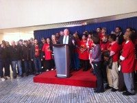 Mayor Rob Ford at a press conference before the executive committee meeting begins. Behind him are members of Unite Here, a pro-casino union.