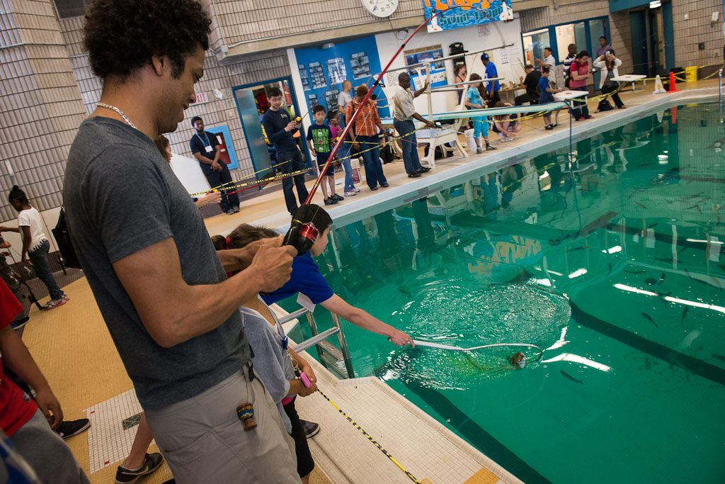 260003 manuel rodriguez gets ready to cast his line - Cool Indoor Pools With Fish