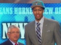 A well-fit suit, an ill-fit draft day cap, a much shorter old white guy, and thou.