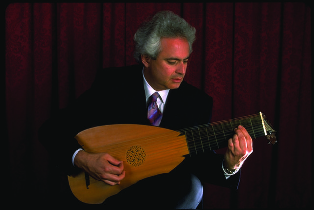 Rafael Benatar handling a baroque lute. Photo by Virginia Lee Hunter.