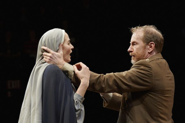 Carmen Grant as Isabella and Tom Rooney as Angelo in Measure for Measure  Photo by Michael Cooper