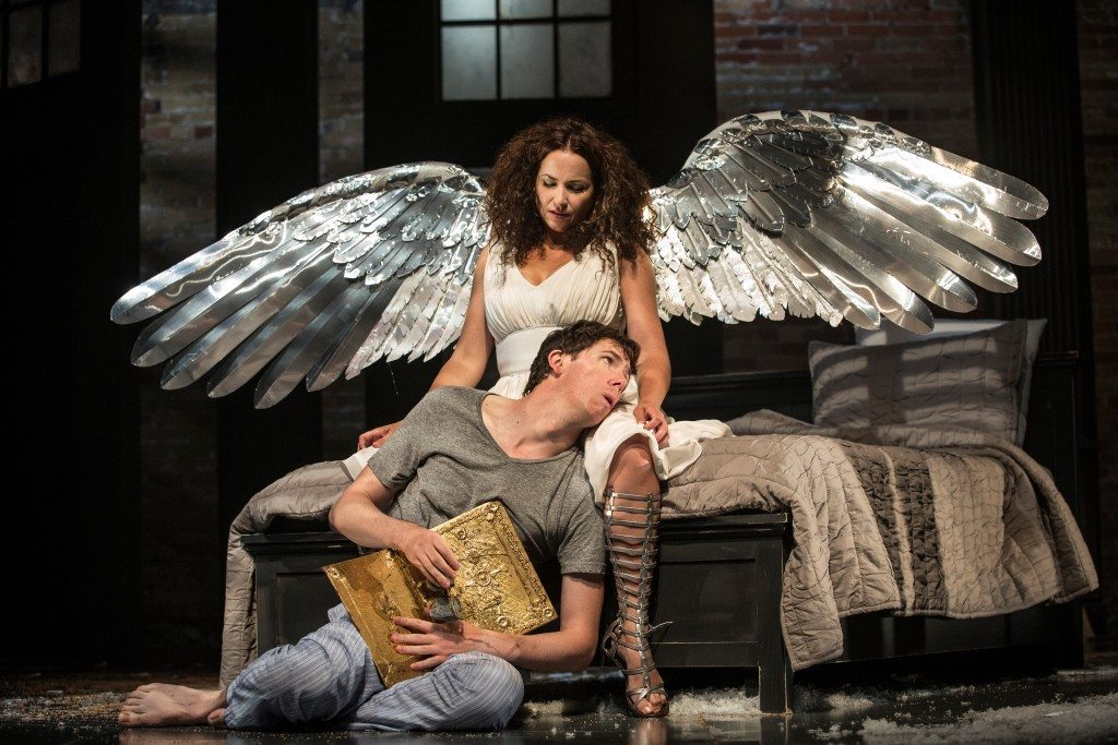 An Angel (Raquel Duffy) appears to AIDS patient Prior Walter (Damien Atkins) in Angels in America. Photo by Cylla von Tiedemann.