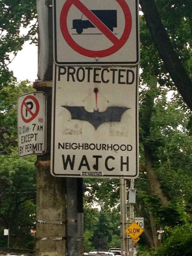 Signs warning about various Superheroes!