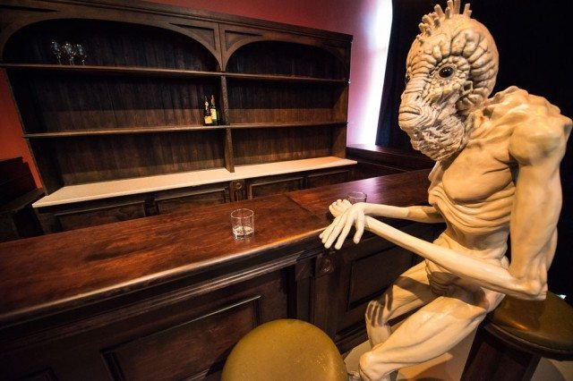 A Mugwump from Naked Lunch tends bar at TIFF's David Cronenberg exhibit
