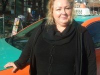 Shirley Marashi in front of her taxi.